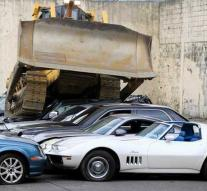 Bulldozer crushes 30 luxury cars