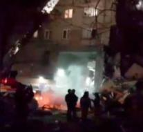 Flat Russia collapses, possibly people under the rubble