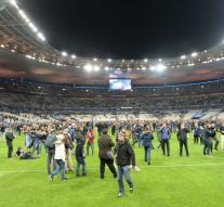 Football supporters on the field in Paris
