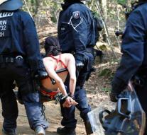 Police drags environmental activists from forest
