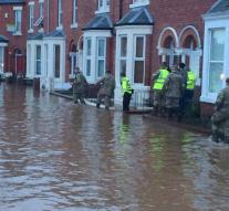 Prime Minister Cameron looks at floods
