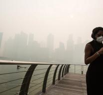 Travelers are stranded in Singapore by ash cloud