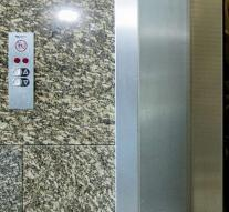 Woman falls meters down elevator shaft