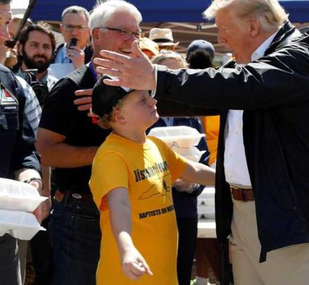 Hurricane affected kid to Trump: 'Can I have a hug?'